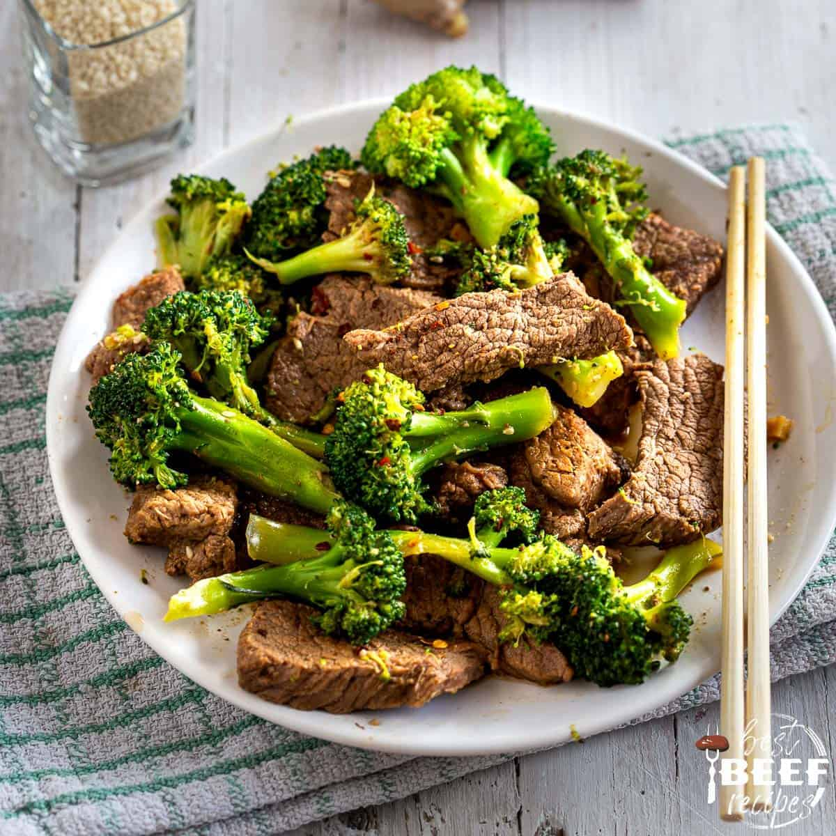 Close up of low carb beef and broccoli with chopsticks