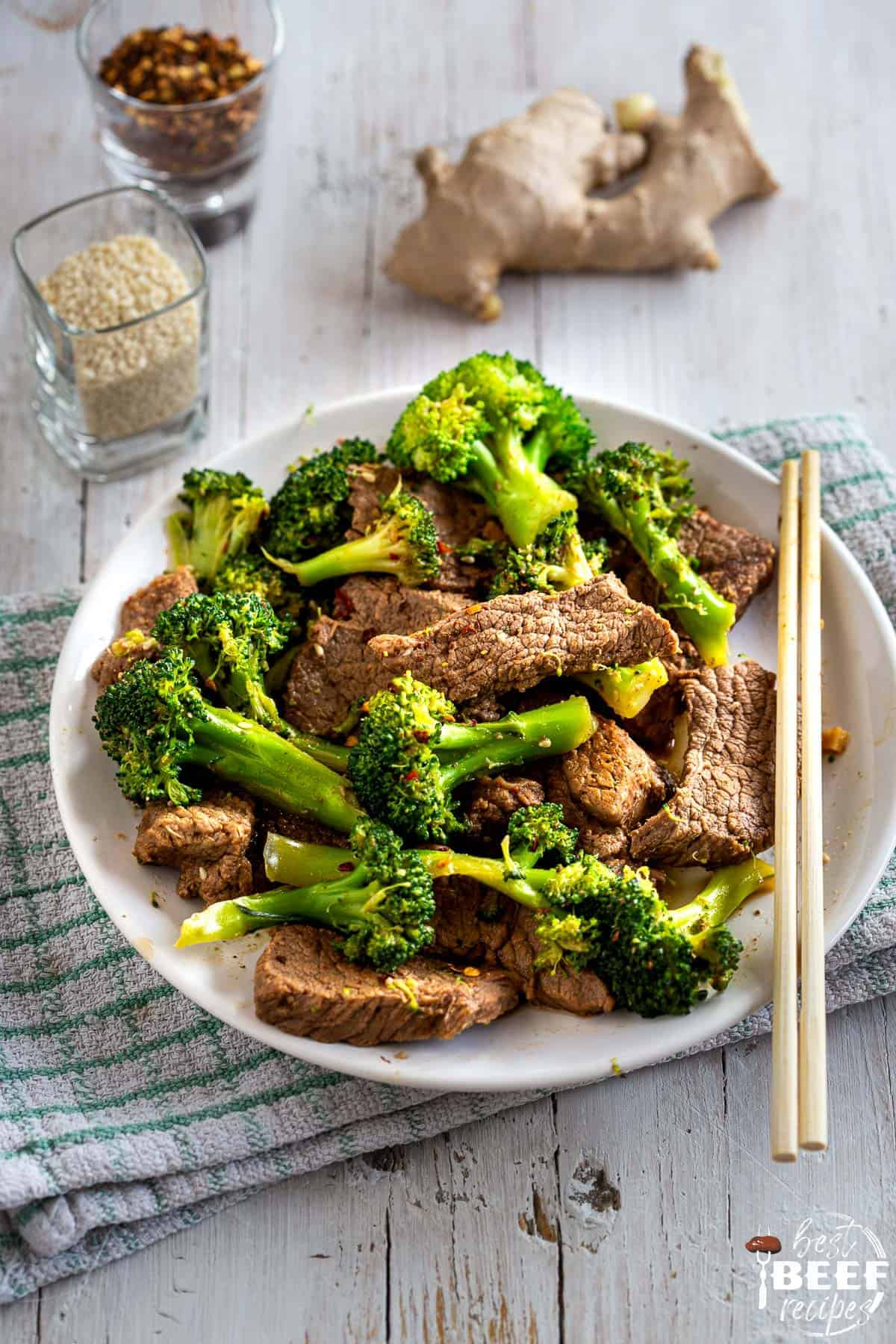 Keto beef and broccoli on a plate with chopsticks