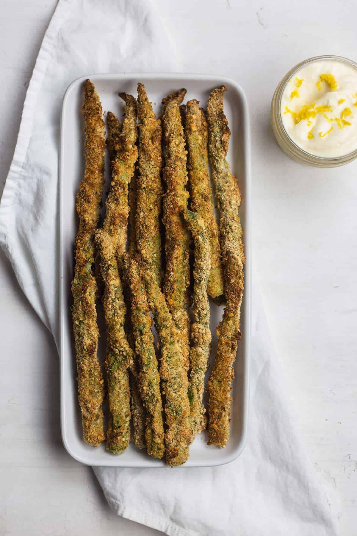 air fryer asparagus fries on a white platter