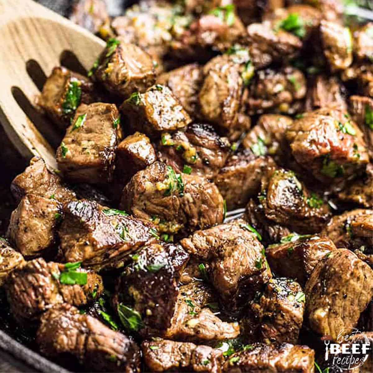 Close up of garlic butter steak bites in the skillet