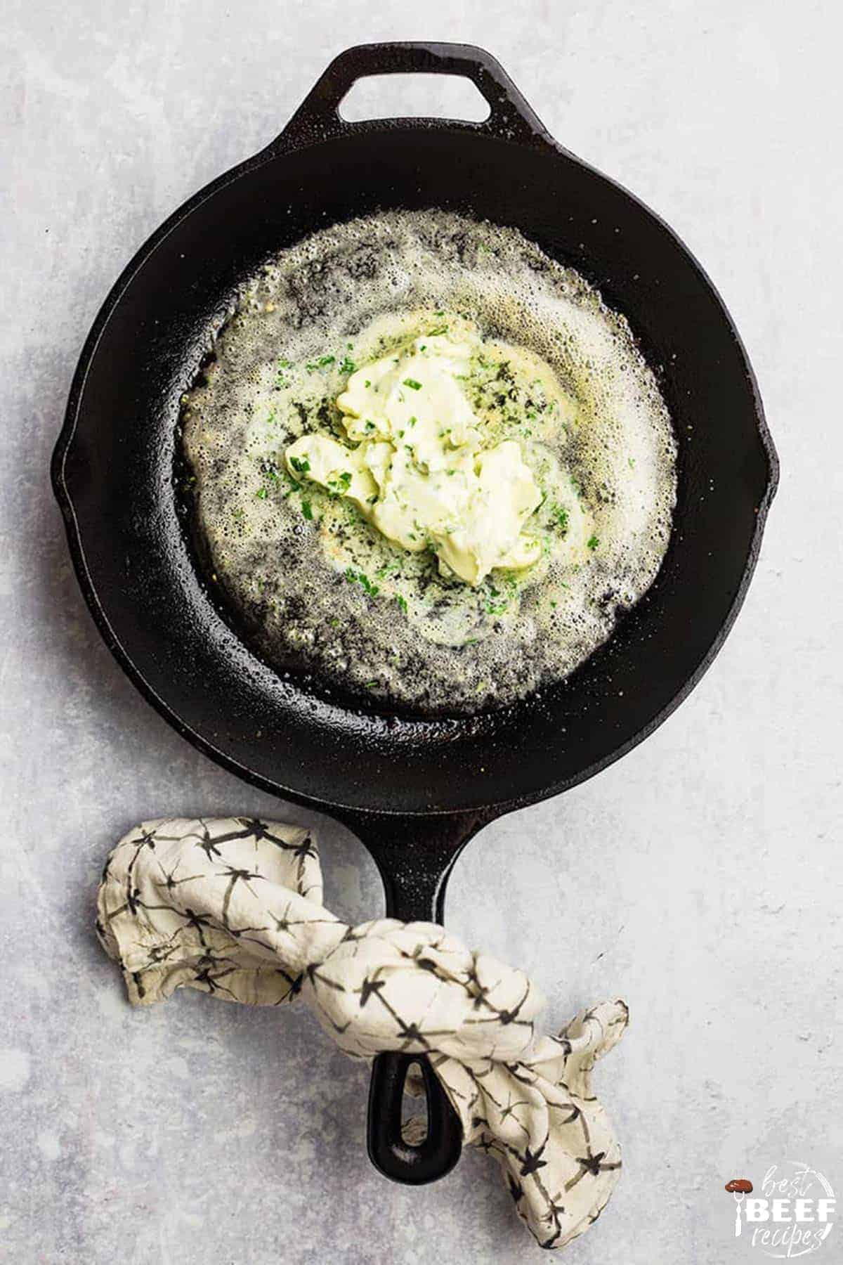 Melting the garlic butter in a skillet for garlic butter steak bites