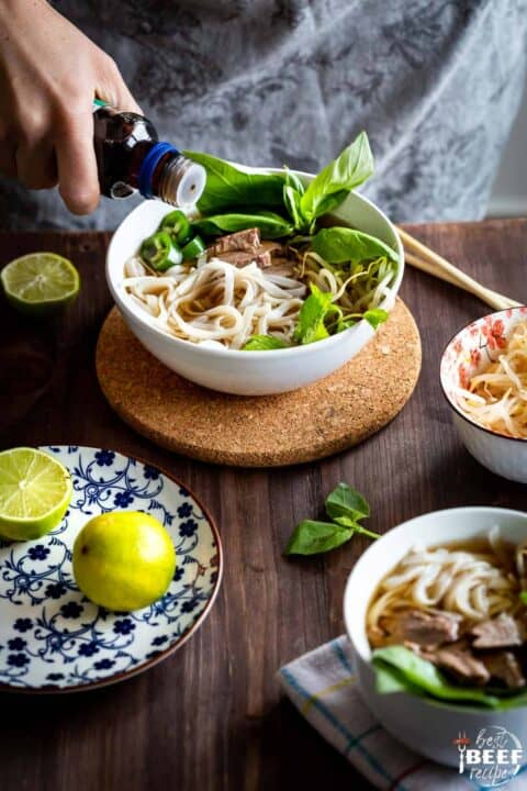 Adding sauce to bowl of instant pot beef pho
