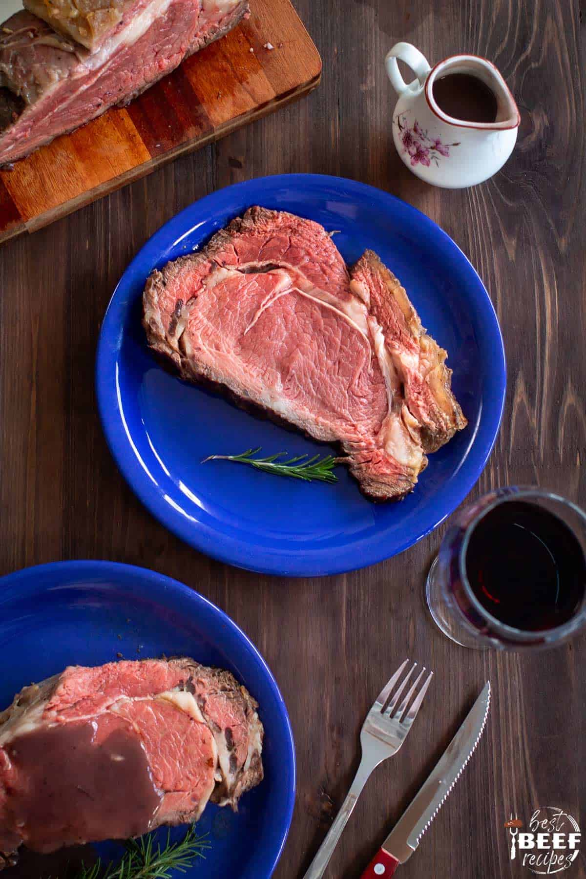 Two blue plates of instant pot prime rib