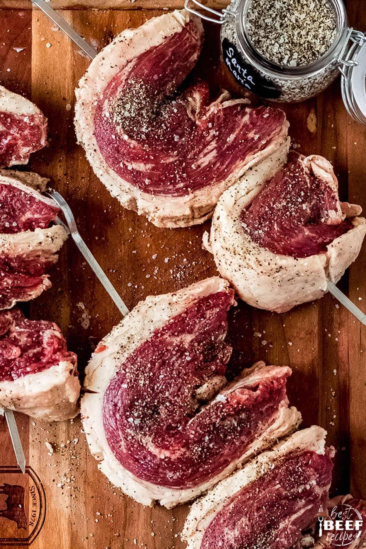 Raw picanha steaks after skewering