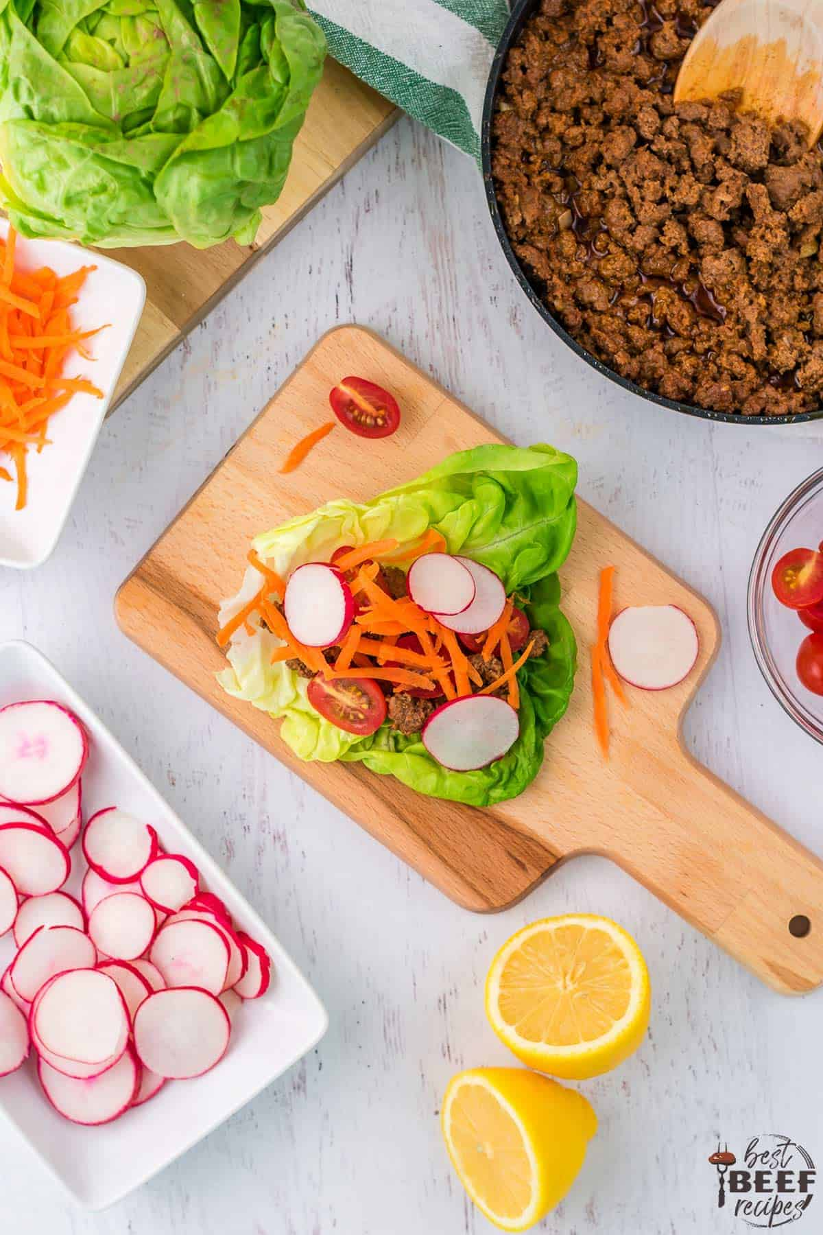 Portuguese-style beef lettuce wraps recipe on a wooden serving board