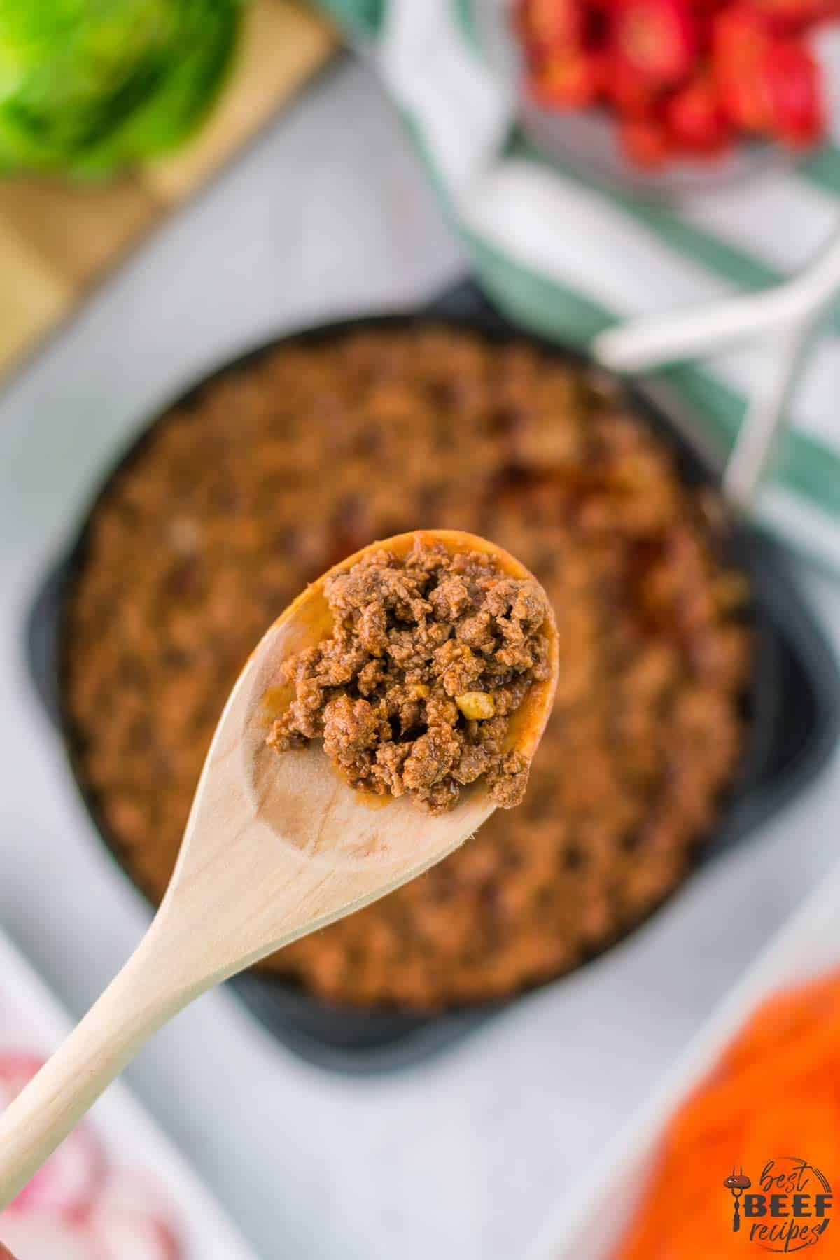 Wooden spoon of ground beef