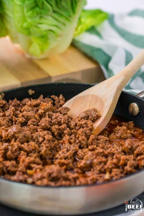 Stirring ground beef in skillet