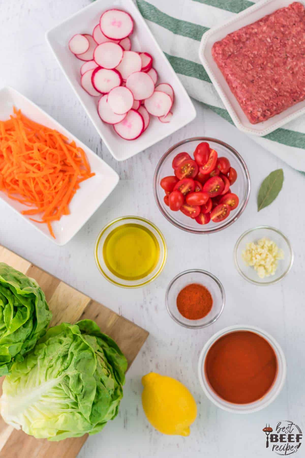 Ingredients for Portuguese ground beef lettuce wraps recipe on table next to each other