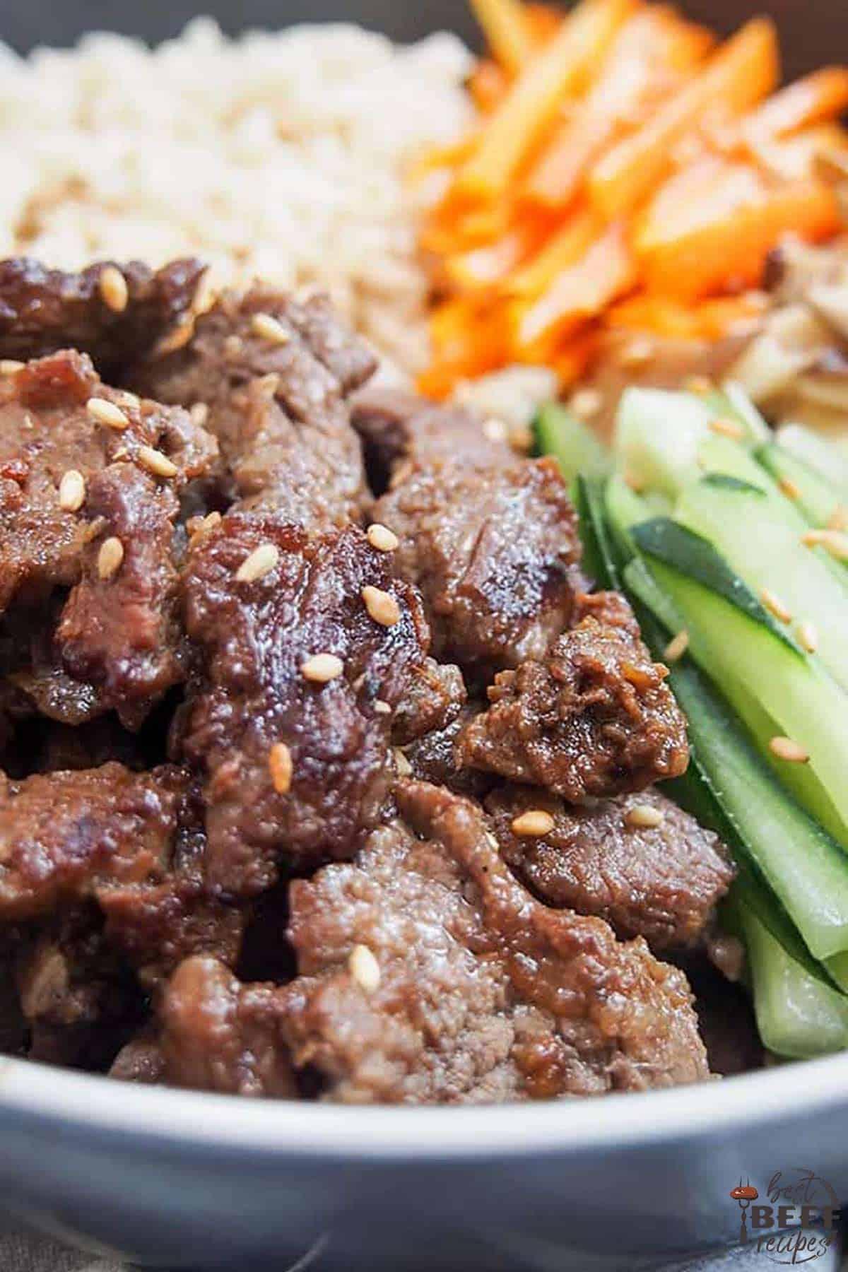 Close up of Korean beef bulgogi bowls with cucumber and carrots