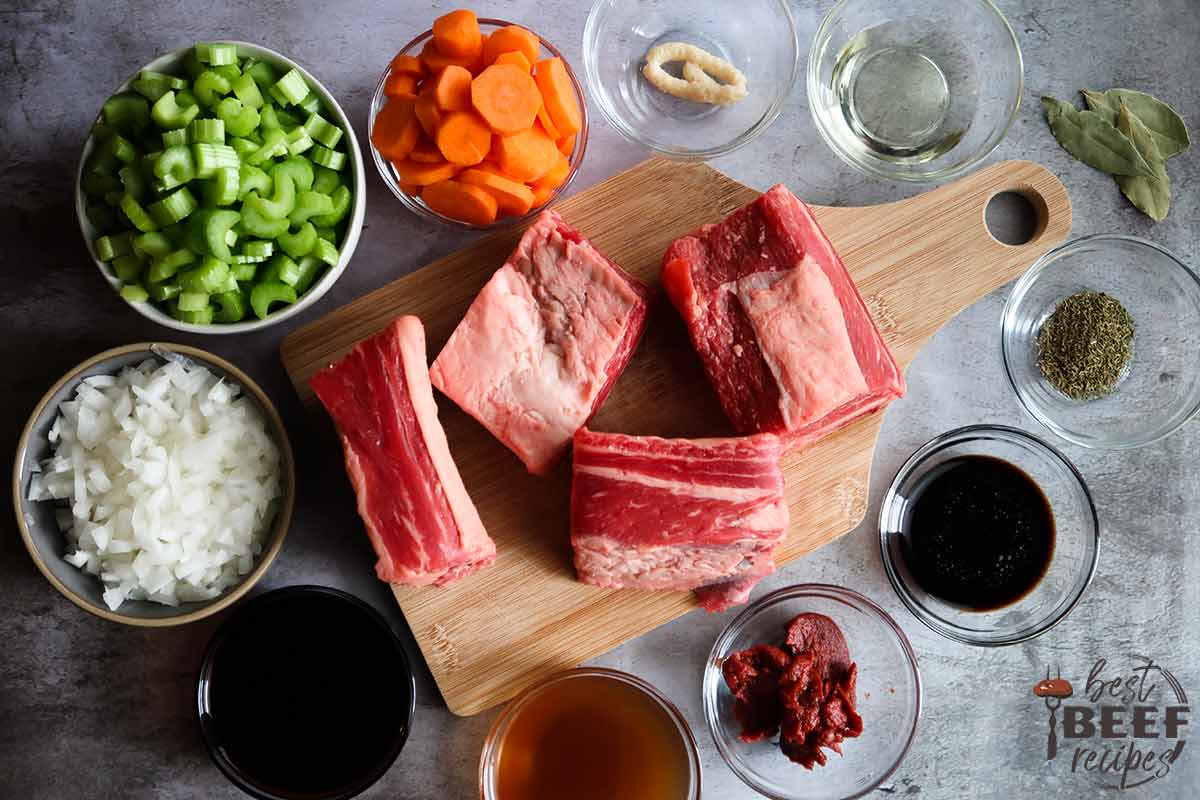 Ingredients to make slow cooker beef ribs on a grey surface