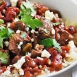carne picada up close in a white bowl with cilantro on top