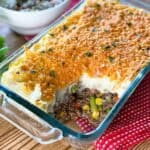 Close up of Instant Pot Shepherd's Pie in a glass casserole dish with a portion missing
