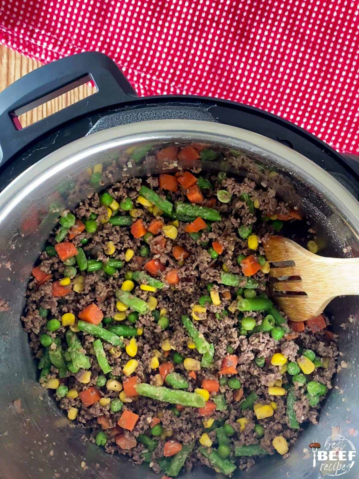 Mixed vegetables and ground beef cooking in the instant pot