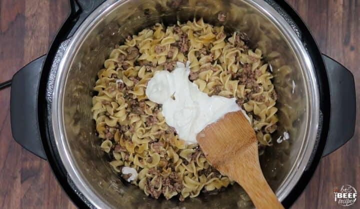 Mixing sour cream into the instant pot beef stroganoff