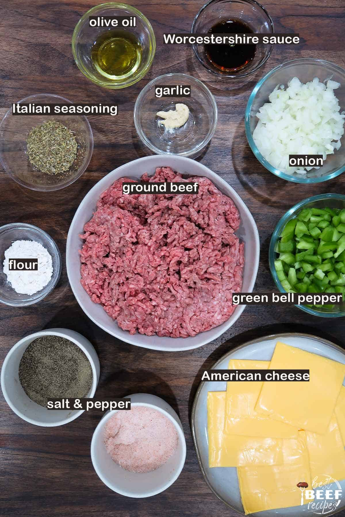 Ingredients to make instant pot philly cheesesteak sloppy joes laid out on a table with labels