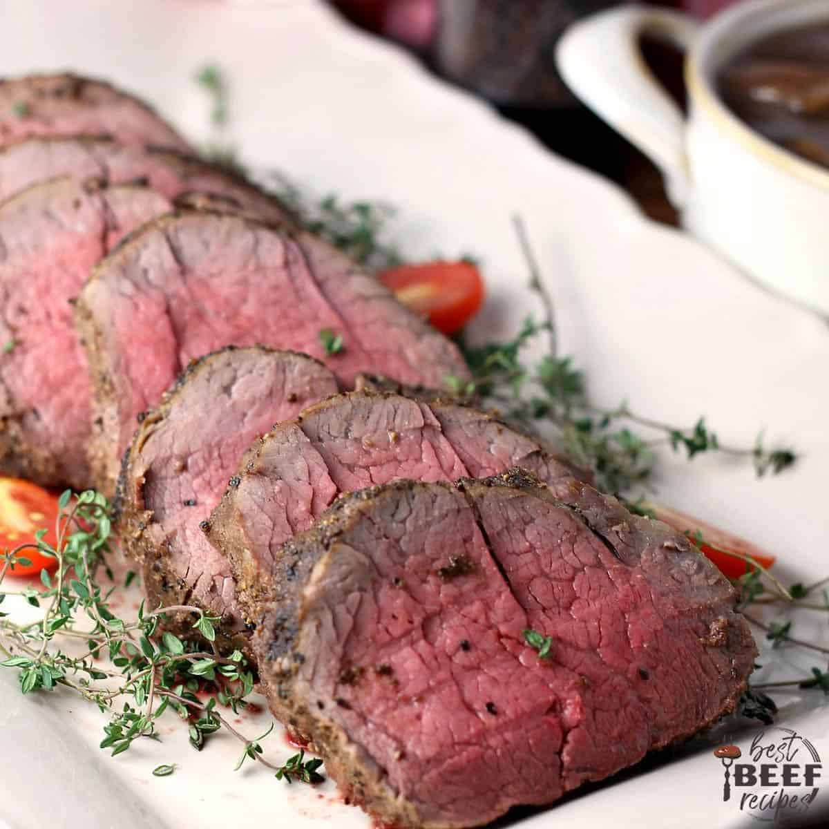 Slices of whole beef tenderloin on a white platter