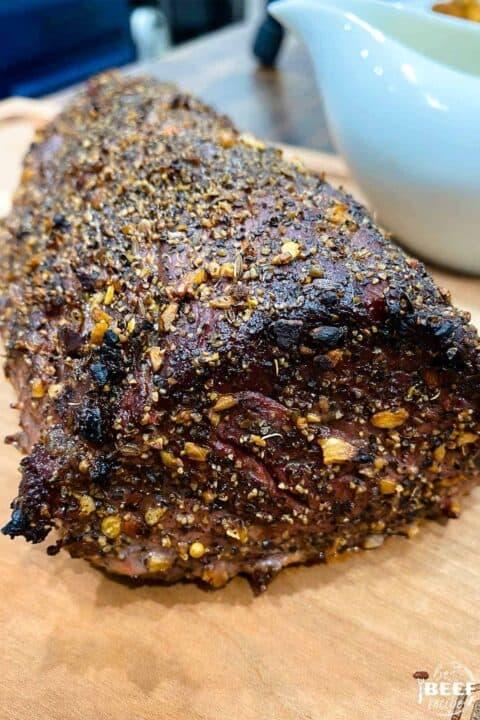 Seasoned beef tenderloin on a cutting board
