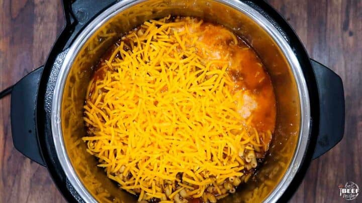 Instant pot chili mac in the pot topped with cheese