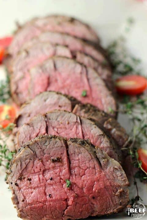Sliced whole beef tenderloin on a platter