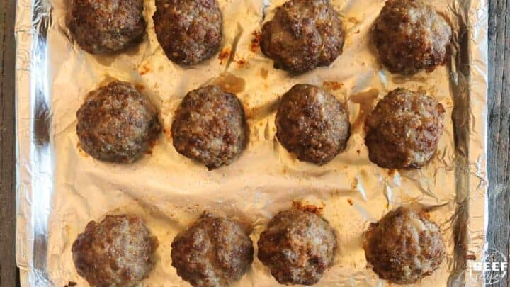 Cooked meatballs on an air fryer rack