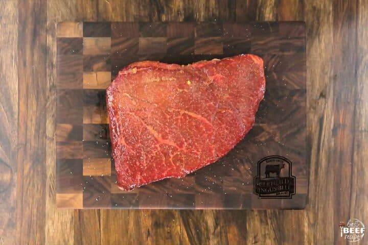 London broil seasoned on cutting board