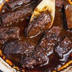 Cooked Korean beef short ribs in a Dutch oven