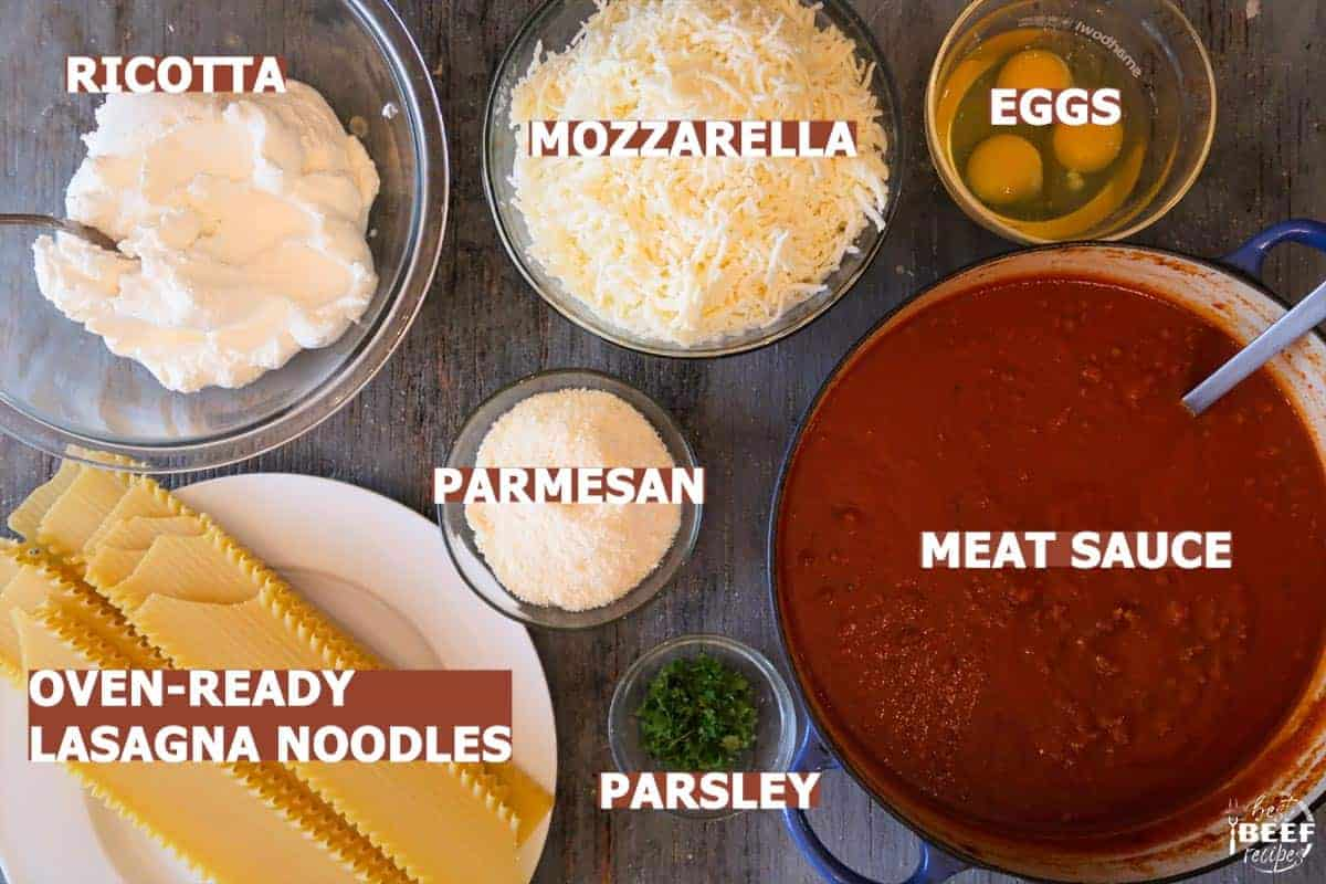 ingredients to make slow cooker lasagna labeled on a table