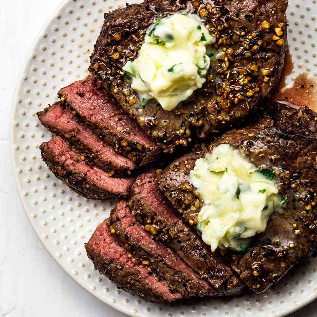 Air fried steak in slices with garlic butter for steak on top
