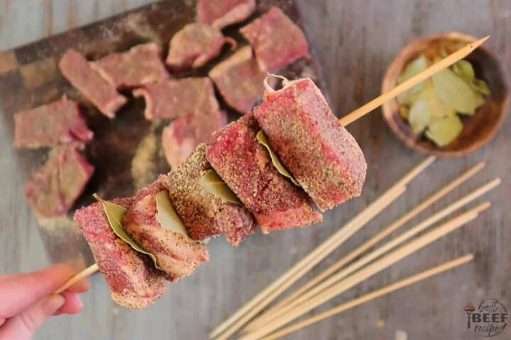 Layering beef kabobs on skewers