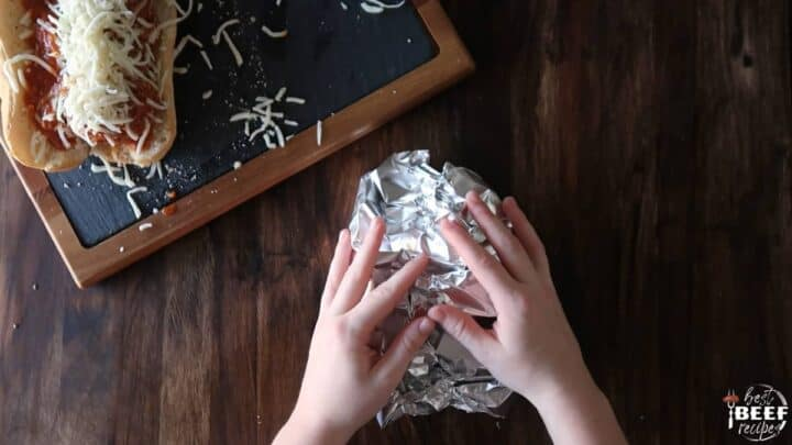 Wrapping sandwich in tin foil