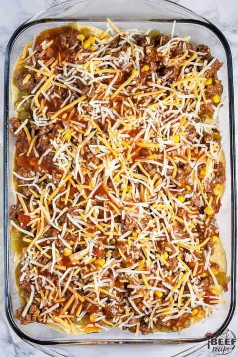 Layered Mexican lasagna ready to bake