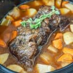Slow cooker chuck roast in the crockpot with potatoes and carrots