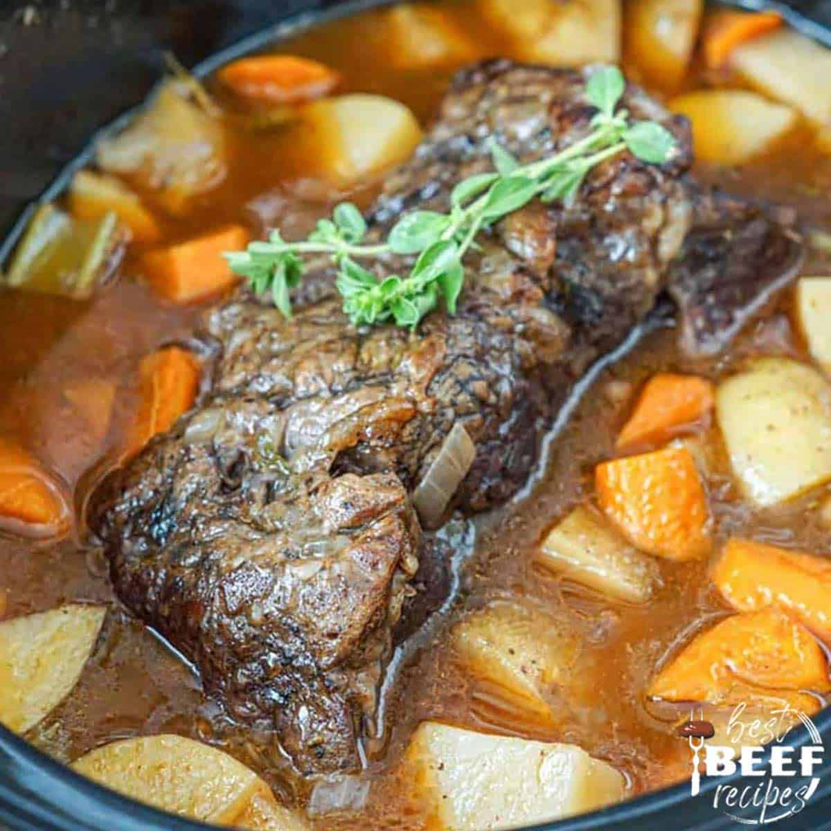 Slow cooker roast beef with potatoes and carrots in crockpot