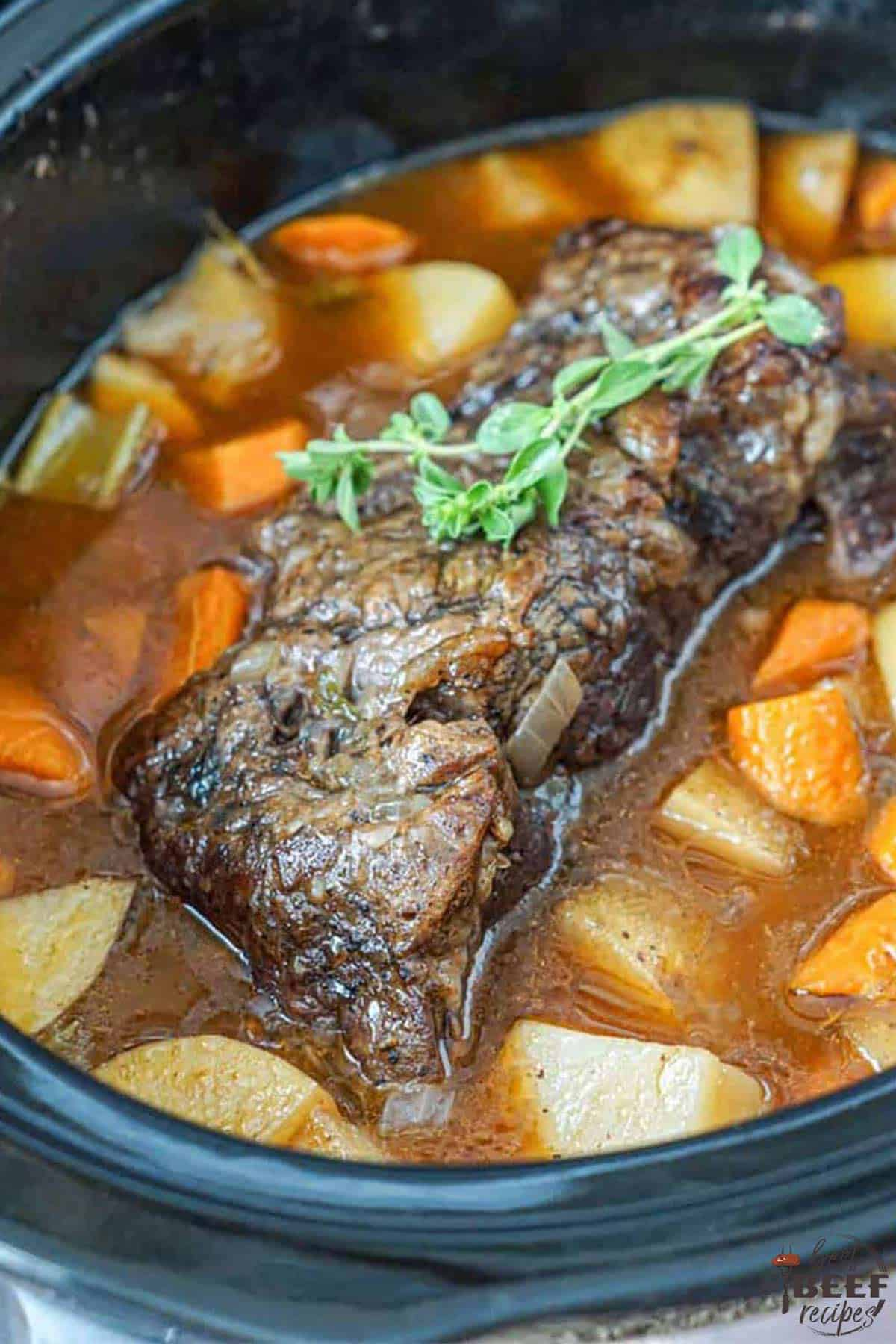 slow cooker pot roast with red wine in crockpot