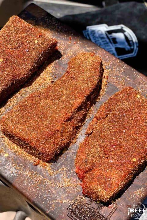 Seasoned beef short ribs on a cutting board