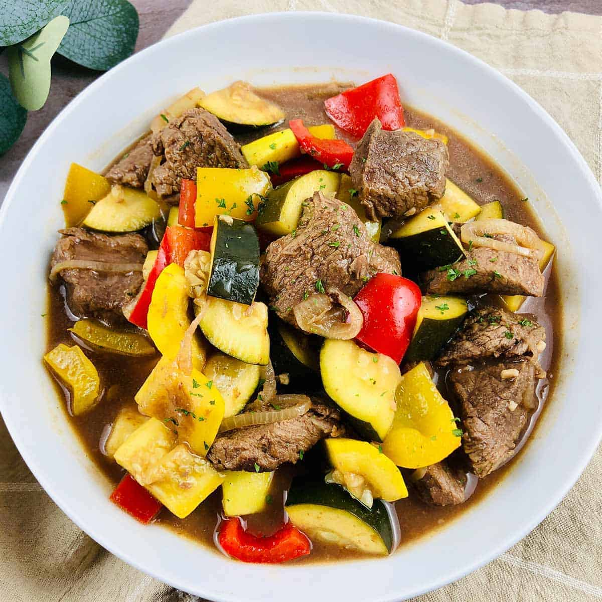 Vegetable beef stew in a white bowl