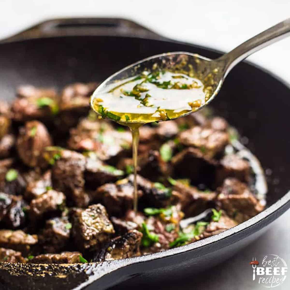 Pouring garlic butter over steak bites