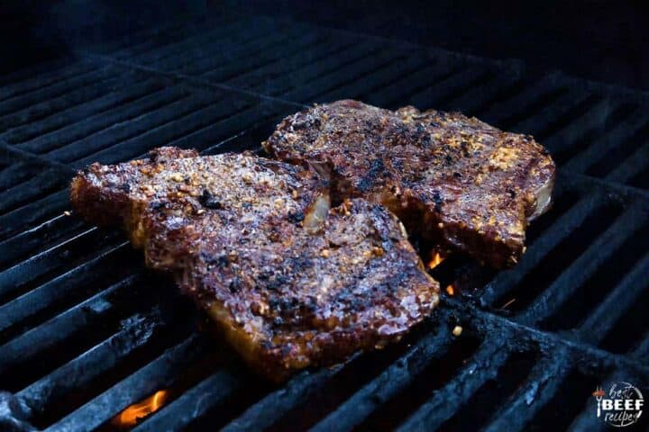 Two rib eye steaks on the grill