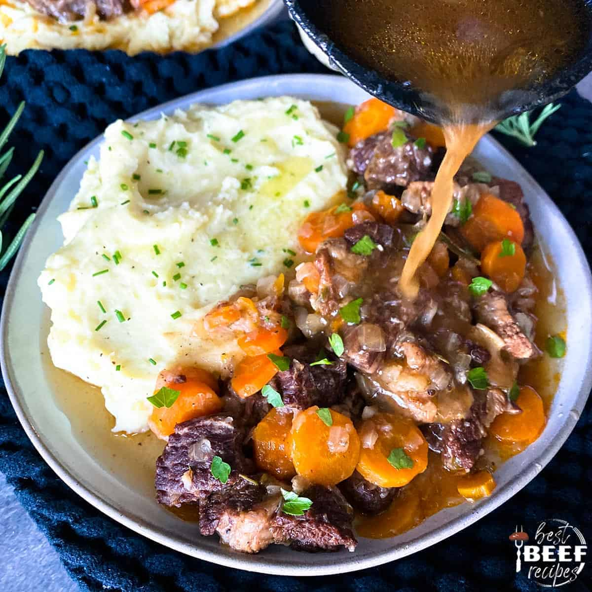 Pouring sauce over beef short ribs on plate with mashed potatoes