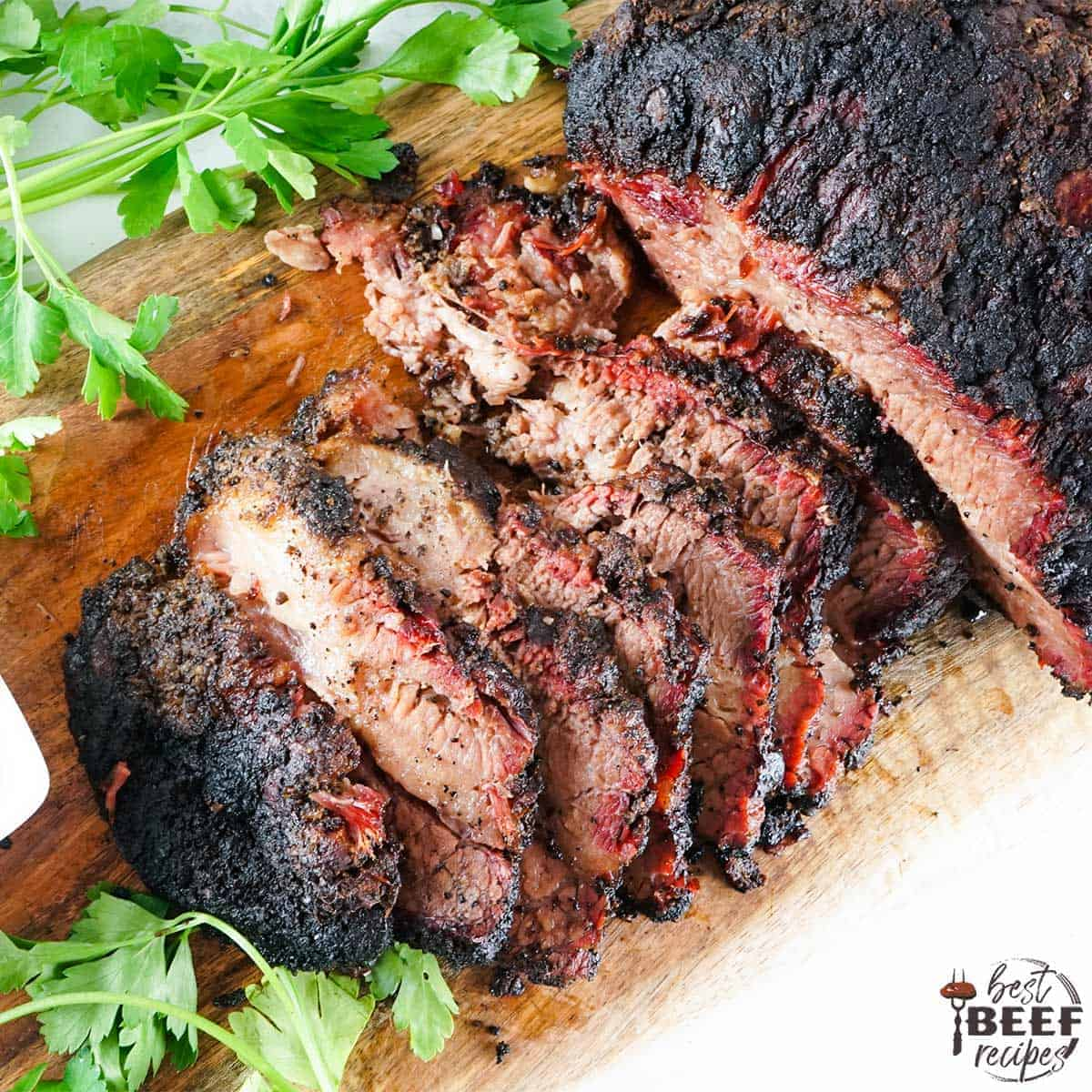 sliced smoked brisket on a cutting board