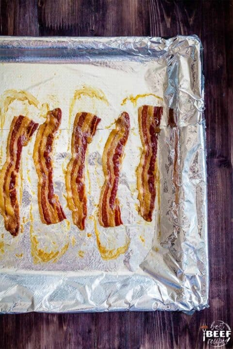 Crispy bacon on a baking sheet lined with foil