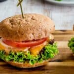 Close up of two smash burgers on a cutting board