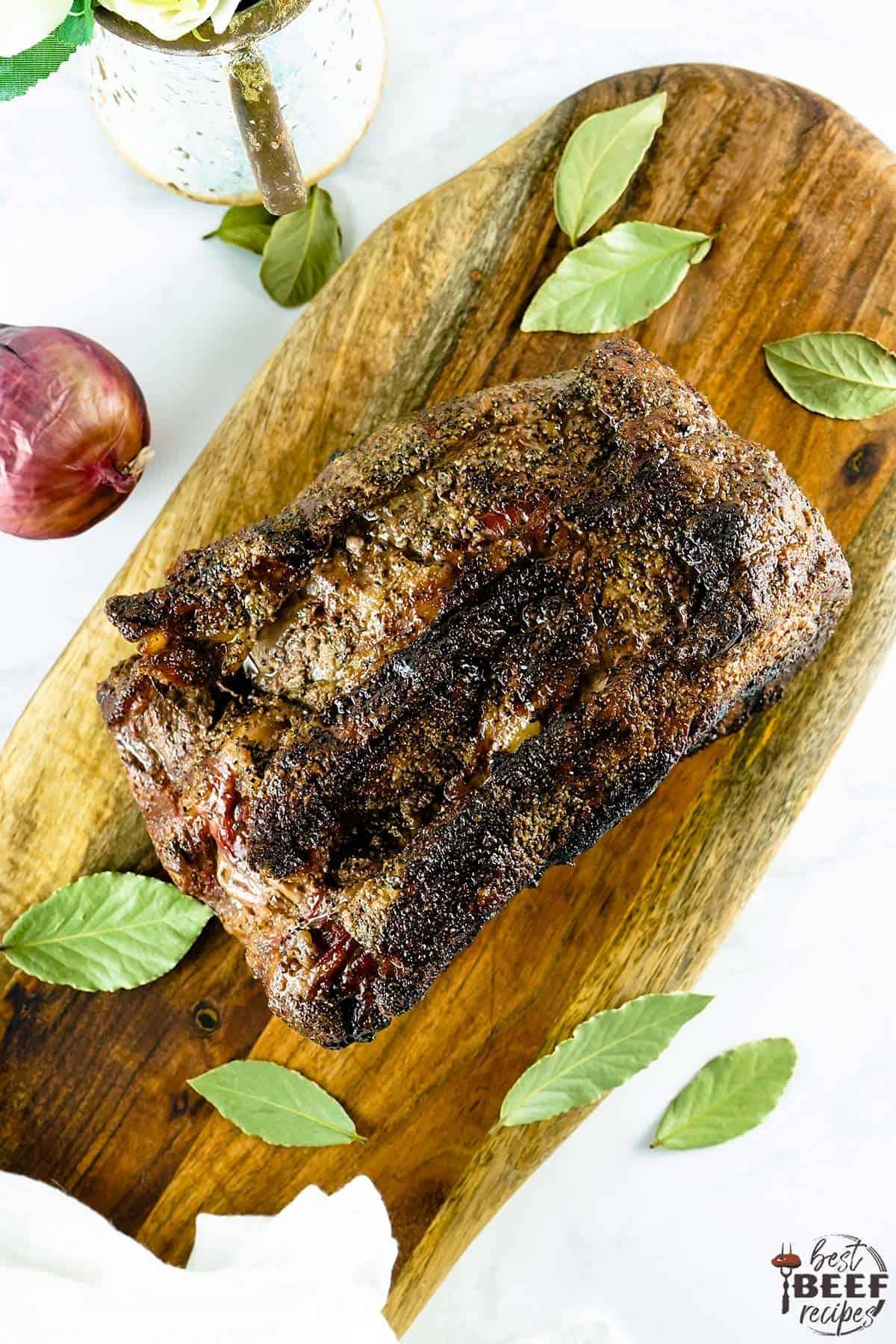 Whole smoked prime rib on a cutting board