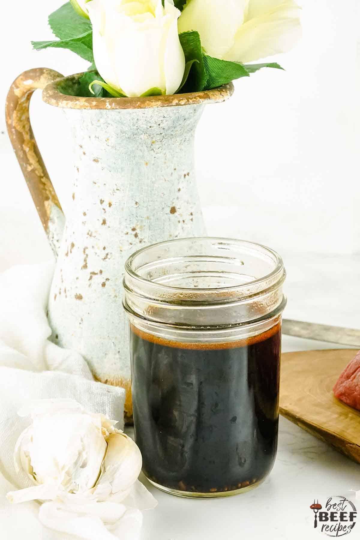 An open  jar of Asian marinade for steak