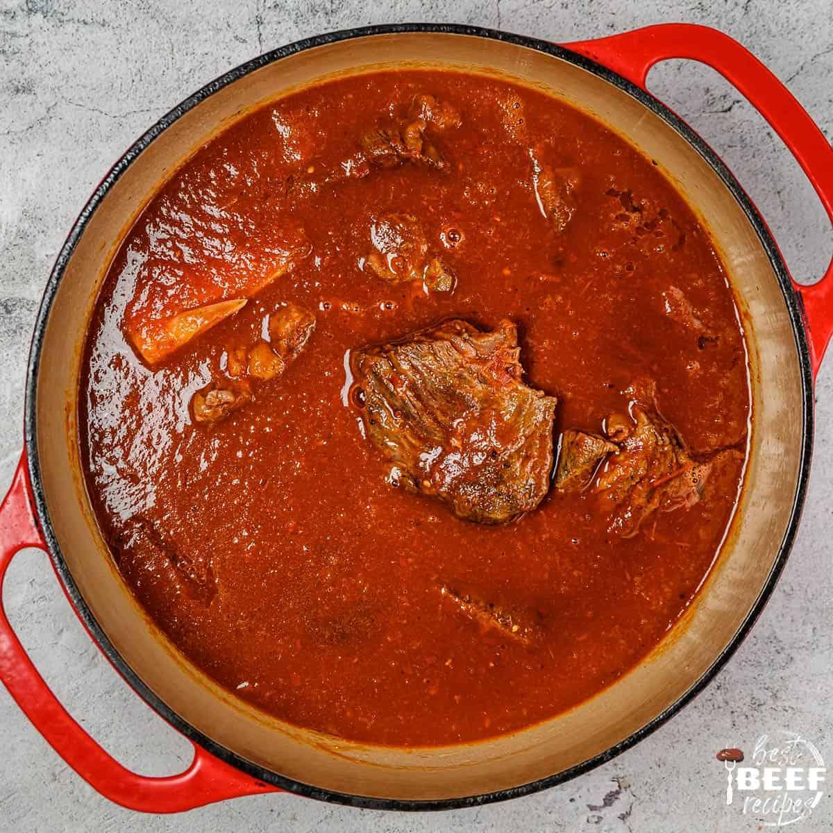 Birria beef stew in a dutch oven pot
