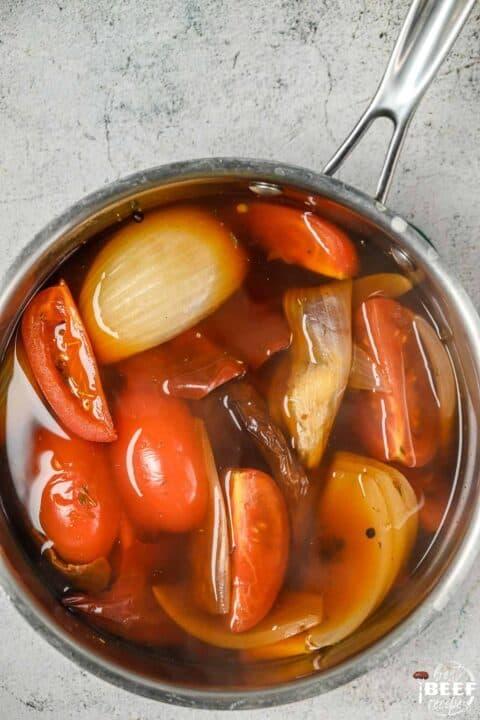 Birria stew cooking in pot