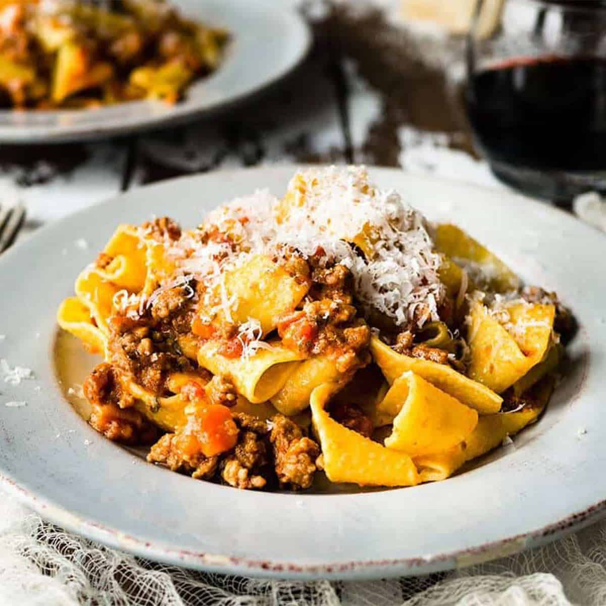 Homemade bolognese with pappardelle up close on a plate