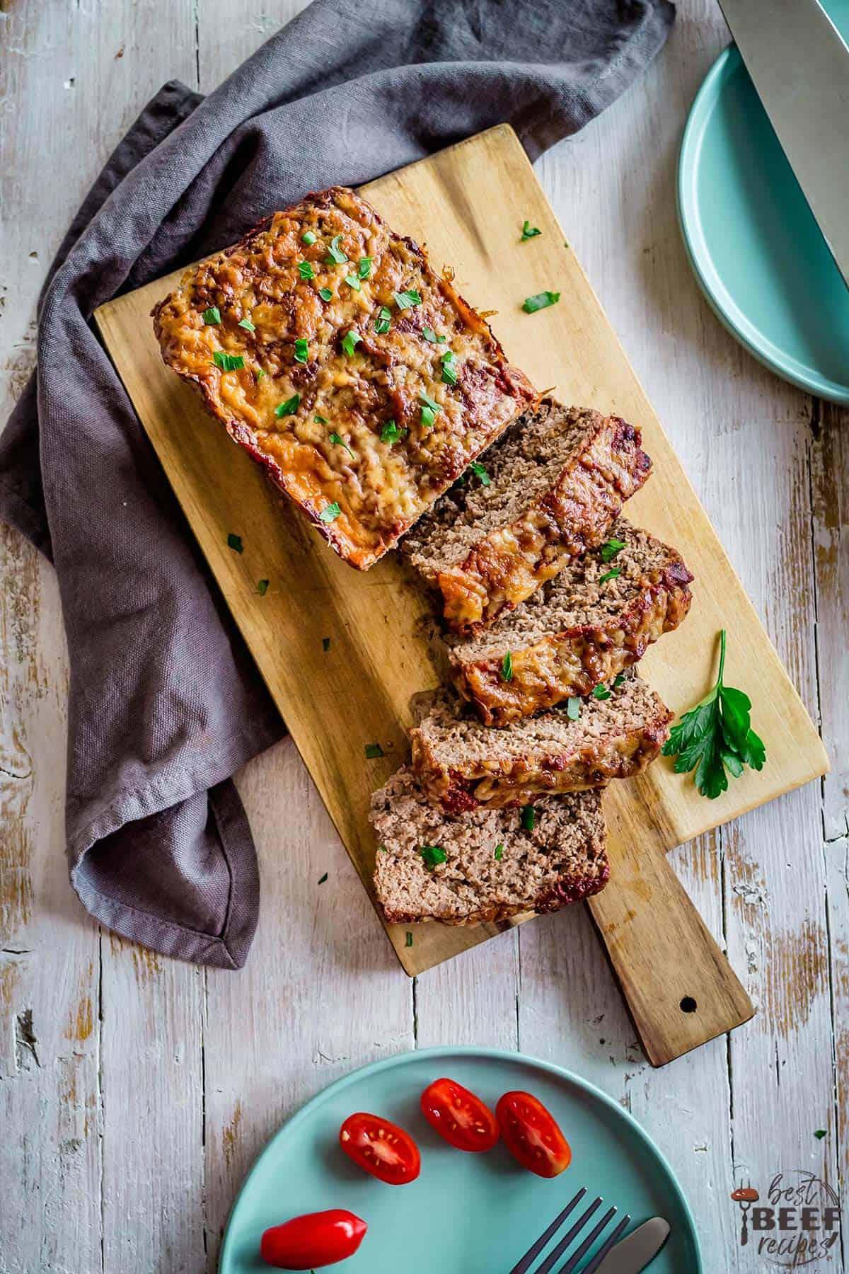 Keto meatloaf on a wooden serving board