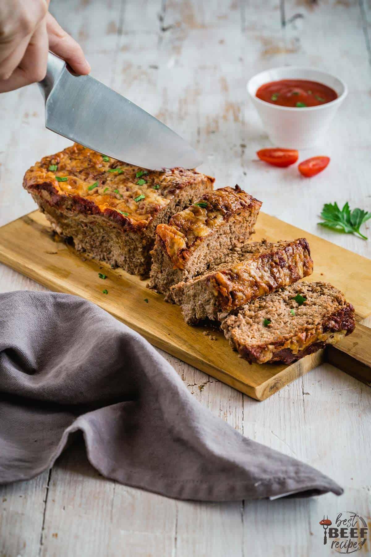 Slicing meatloaf with a knife