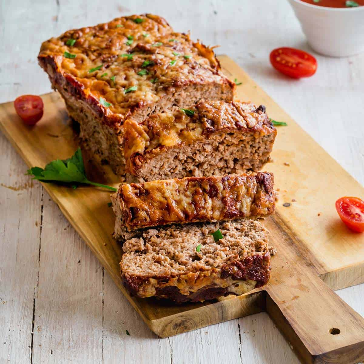 Keto meatloaf sliced on a wooden board